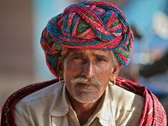 Just keeping an eye... (ingetje tadros) Tags: travel portrait people india color men beautiful face look rural eyes jewelry tribal silence rajahstan bishnoi tribel earthasia ingetjetadros