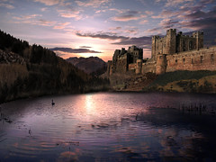Dusk at the Castle (DDA / Deljen Digital Art) Tags: uk trees light sunset shadow england sky cloud sun lake mountains colour reflection castle history nature water composite skyline forest photoshop sunrise walking landscape fun countryside pond woods scenery waiting frolic view digitalart scenic hills created climbing northumberland creation burn cover blended boating mysterious dodge imagination layers grasses fortification filters sunrays solitary magical bamburgh stronghold atmospheric fantasyland imaginative blend enhance herethere layered cs4 wizardry fantasyworld photographcart