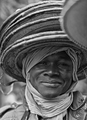 You like to buy a hat madam? (ingetje tadros) Tags: africa travel portrait people india art smile face rural community faces traditional egypt culture streetphotography afrika tradition ethiopia mali indigenous travelphotography ingetjetadros