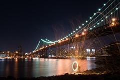 Resplendent Metropolis (joo0ey) Tags: nyc newyorkcity bridge lightpainting brooklyn lights manhattan dumbo brooklynbridge manhattanbridge steelwool andsomeonescreamedlookovertherelookoverthereastheytriedtogatherusmuchunwantedattentionthentheshowendedasoursteelwoolhitthewater