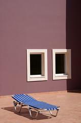 Just loungin (The Green Album) Tags: windows sun pool hotel graphic terracotta stripes greece crete loungin lounger bold superaplus aplusphoto