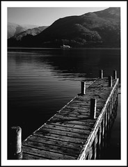 a moment to reflect (chris-tography christomo47@yahoo.co.uk) Tags: wood lake water dark pier blackwhite interesting shadows sony lakedistrict lakeside boardwalk alpha marvel pillars a200 tones steamer depth 1870mm tonal hoya cumbrian freeflight noexplore explorethis ullswaterjetty robchisholm exploremyass