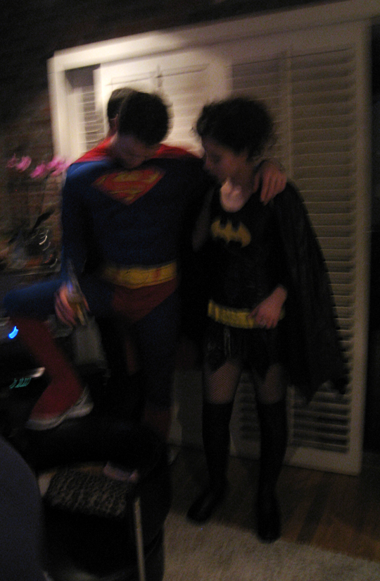 halloween party pics+superman and batgirl