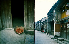 Xingping village on Li river (avezink) Tags: china street trip travel film analog diptych basket kodak duet slide doorway peppers  halfframe   e100vs streetscape province guangxi chaika   sovietcamera colorreversal   ctrippic