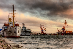 Port Of Gothenburg (Cederquist Christoffer) Tags: industrywatercraftshipwaterharborshipmentpierseafreightportvehiclecraneunloadingboatsunsetskylogisticsheavymoodyhdrtonemappedgothenburgswedencederquistweatherwarship
