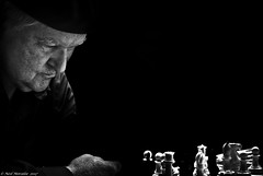 The Darkmaster. (Neil. Moralee) Tags: neilmoralee usa2017neilmoralee man chess dark sinister master grand grandmaster play player playing board good evil bad nikon d7200 neil moralee portrait mature old frenh quarter new orleans usa louisiana magic mystical battle concentration art darkarts blackandwhite bw bandw mono monochrome face challenge trial test people