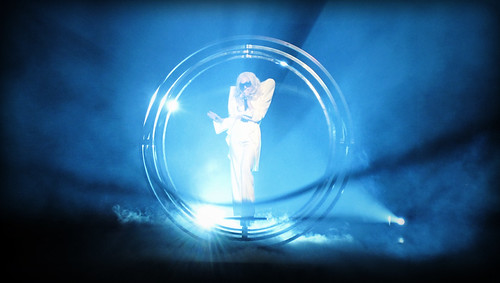 Lady Gaga in Vancouver: Lady Gaga performs inside a giant metal circle, lit with blue lights and surrounded by mist and smoke.
