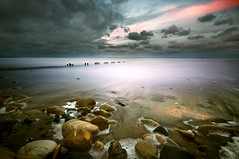 Bloody Freezing (dan barron photography - landscape work) Tags: pink light sunset cold weather clouds reflections coast rocks jetty web freezing submerged swell floatsom