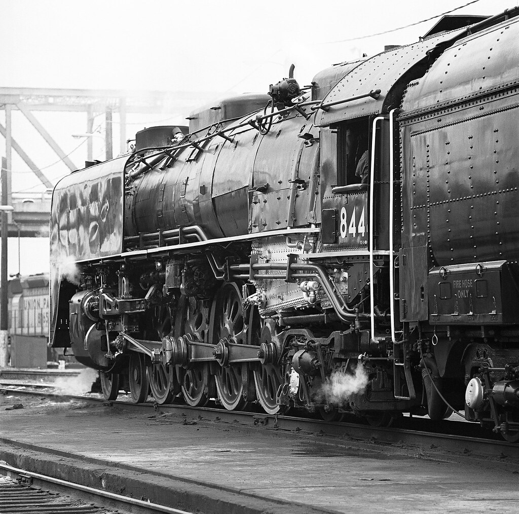 Union Pacific steam locomotive # 8444, is being prepared for the following day's railfan trip at the railroad yard in Denver, Colorado, 1980