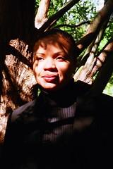 Portrait in Park (Carla Y. Brown) Tags: smile youth grace contemplation autumnportrait carlasbestwork bestworksofcarla winterwomanscollectionofphotos