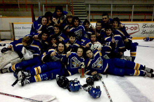 The Boys Eagles Hockey team celebrates winning the A side championship in Winkler this weekend. (submitted photo)