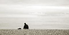 Alone (grahambrown1965) Tags: sea people blackandwhite white black beach water sepia person alone pentax shingle shore figure toned solitary tone toning 1645mm k20d justpentax pentaxk20d smcpda1645mmf40edal pentaxart
