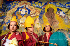 Buddhist Child Monks I (© Poras Chaudhary) Tags: red india yellow festival kids zeiss 35mm children three nikon play dress traditional hats monks carl monsters ladakh thiksey