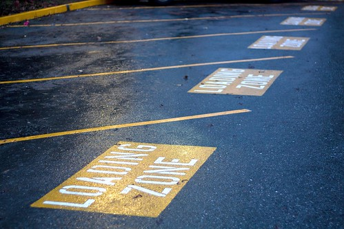 The conversion of 20 student parking spaces into yellow loading zones has made the already difficult campus parking situation even more troublesome for commuter students.  Photo by Alexander Crook/Foghorn