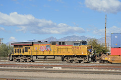 UP General Electric C45ACCTE locomotive 5501, pushing an eastbound container train, Tucson Yard, Arizona, January 14, 2010 (Ivan S. Abrams) Tags: railroad up train trains goods unionpacific motive freighttrains railyard railways railroads railyards freighttrain uprr shuntingyard unionpacificrailroad electricnikon d700 onlythebestare ivansabrams trainplanepro countysouthern ivanabrams shuntingyards traingoods trainsarmour yellowharbor graytucspnarizonapima arizonasoutheast arizonaemdgeelectromotive dieselelectro dieselgeneral abramsandmcdanielinternationallawandeconomicdiplomacy ivansabramsarizonaattorney ivansabramsbauniversityofpittsburghjduniversityofpittsburghllmuniversityofarizonainternationallawyer