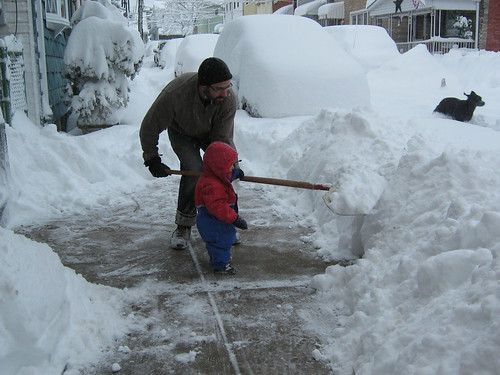 Silas helping Papa shovel