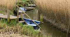little boats, norfolk. (Adam Swaine) Tags: uk england water beautiful rural creek canon boats countryside village britain norfolk waterways bullrushes cleynexttosea thisphotorocks adamswaine mostbeautifulpicturesmbppictures wwwadamswainecouk