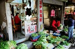 Underwear seller wishes she had become a greengrocer (deepstoat) Tags: street colour vegetables zeiss market knickers taiwan undies 2010 bras contaxg2 pakchoi kodakportra bestoftaiwan deepstoat