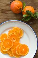 oranges, too (mwhammer) Tags: blue summer food orange white color green texture fruit fun design spring bright display delicious repetition mandarinoranges simple refreshing slices orangeslices freshfromthetree foodstyling melinahammer tobebaked