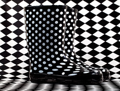 Polkaboots (PeterChad) Tags: light white black canon mono design shoes pattern boots flash optical rubber polkadots illusion footware wellington 5d harlequin strobe