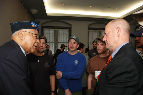 Walter Morris a former 1st Sgt of the 555th Parachute Infantry Regiment Smoke Jumpers, speaks with Deputy Chief for Business Operations, U. S. Forest Service Chuck Myers. The Smoke Jumpers visited the the Forest Service on March 26, 2010 in Washington, D. C.