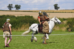 Roman Warrior on Horseback Throwing Spear, Kelmarsh 2009 (Steve Greaves) Tags: red horses italy rome field leather silver army gold countryside italian ancient war uniform catchycolours dress arms roman juliuscaesar sandals military helmet battle horsemen event riding hedge mounted sword imperial conflict soldiers historical shield warriors recreation armour period invasion reenactment horseback troops romanempire reenactors equine authentic legion romans invading armoury reconstruction invaders cohort legionary gallop riders spear horseman livinghistory reenacting warfare breastplate englishheritage kelmarsh erminestreetguard romansoldiers gladius battledress romanarmy kelmarshhall paxromana nikond300 fightingforce 43ad