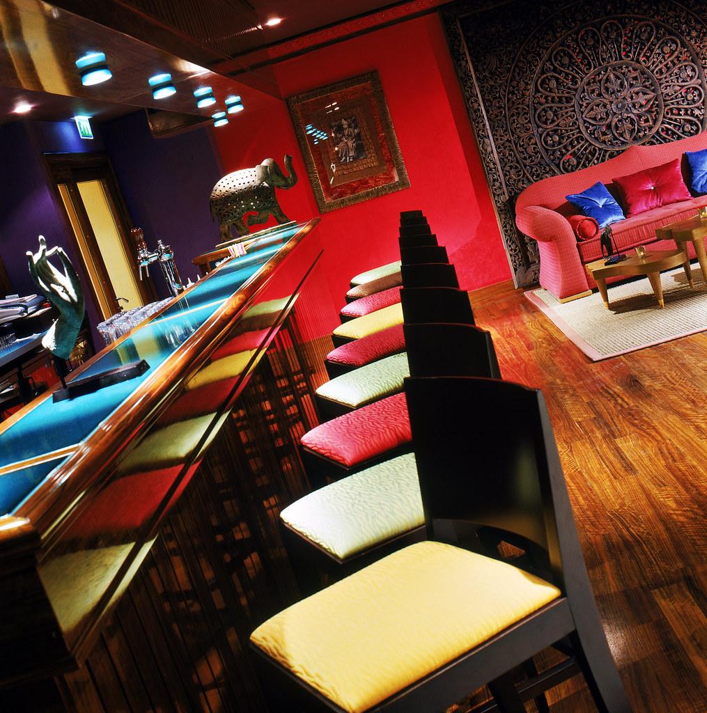 Bright colorful high chairs at Le Pingala Bar at Palais de la Mediterranee, Nice , France