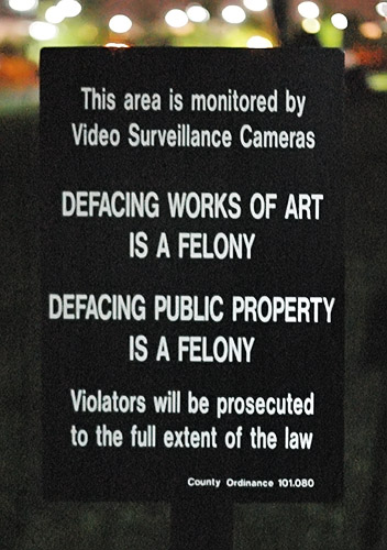 "Sign - ""Defacing works of art is a felony"", in Chesterfield, Missouri, USA"