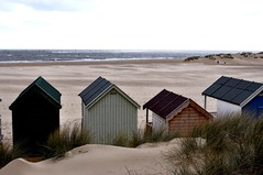 Wells beach huts looking forlornly out onto a windswept beach