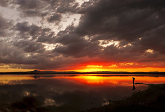 (ssj_george) Tags: sunset shadow red sky people panorama orange mountain lake storm man reflection nature water silhouette yellow clouds umbrella lens landscape outdoors lumix alone view sundown natural wide salt cyprus panasonic saltlake solo single figure pancake 20mm raincoat loner dmc larnaca larnaka f17 gf1 stavrovouni  georgestavrinos   dmcgf1 ssjgeorge
