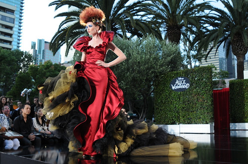 By FIDM Fashion Designer, Clay Sadler, a couture gown inspired by the Red Queen, in a fashion show