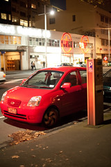 Red Car / Red Light / Red Sign (russellstreet) Tags: red newzealand car sign night auckland parkingmeter nzl beachroad aucklandregion aucklandcbd
