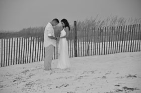 Photo of newlyweds in front of seagrass