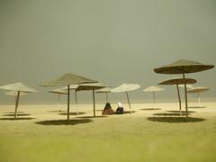 (boscoboscobosco) Tags: shadow two sky beach fog night sand women sitting many muslim horizon center arabic parasol multiple distance umbrellas essaouira burkas essaoeira assuwayrah