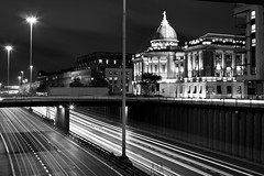 (iain-paton) Tags: road blackandwhite blur building monochrome architecture night scotland highway traffic motorway glasgow library trail busy freeway m8 lighttrail traffictrail themitchelllibrary
