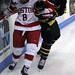 Boston University's Ben Rosen clashes with Merrimack College's Kyle Bigos