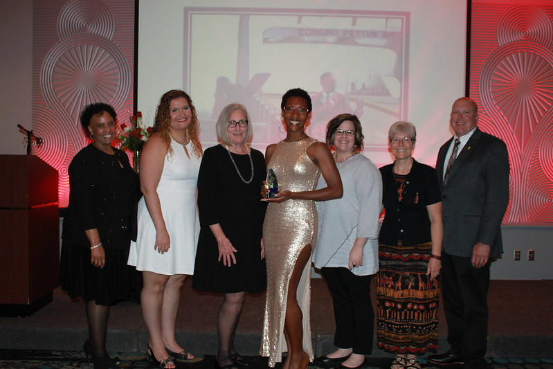 UI Health Care staff join Monique Green in celebrating her award for Emerging Activist at the Juneteenth Trailblazers Awards