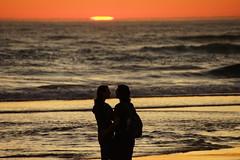 Manzanita Beach (pete4ducks) Tags: manzanita oregon sunset couple 207 summer pacificocean waves water silhouette beach manzanitabeach orange nature sun sky