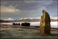 Standing Stone - Acharn (angus clyne) Tags: above old trees light cloud mist snow mountains cold ice grass misty fog stone pine forest sunrise canon grey dawn scotland highlands high ancient sheep angus farm hill perthshire glen hills tay mystical loch prehistoric slope roro stonecircle megalith standingstone clyne flikcr benlawers acharn leefilters colorphotoaward