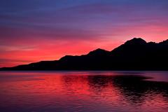 Colors of December morning (*Jonina*) Tags: sea sky reflection sunrise iceland silhouettes 500views ísland 1000views himinn hafið speglun 50faves sólarupprás bej fáskrúðsfjörður faskrudsfjordur skuggamynd impressedbeauty absolutelystunningscapes ubej