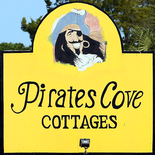 Pirates Cove Cottages Sign