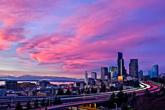 City in Pink (Surrealize) Tags: seattle park city bridge pink trees sunset urban cloud reflection skyline skyscraper flow lights washington nikon colorful long exposure downtown purple traffic state pacific northwest i5 dusk hill explosion freeway pugetsound headlight rizal curve beacon lenticular emerald dri hdr taillight 12thstreet smithtower olympicmountains concretejungle columbiatower d700 vertorama surrealize drjose