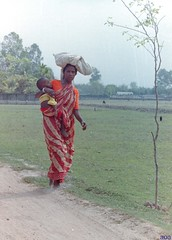 Getting Away With It (bandashing) Tags: poverty road england film 35mm manchester child head path walk poor mother archive oldschool hips negative barefoot dust sari weight sylhet bangladesh carry bandashing january2010entrysoulwoman
