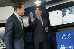 Cisco CEO John T. Chambers takes a Flip Video of Governor Arnold Schwarzenegger during the press conference. (Cisco Pics) Tags: john video technology schwarzenegger governor health cisco flip healthcare chambers telemedicine telepresence healthpresence