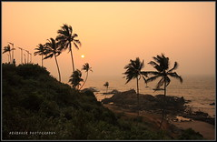(Abubaker) Tags: sunset sea vacation orange india tourism colors yellow goa calangute beaches destination coconuttrees vagatorbeach gettyvacation2010