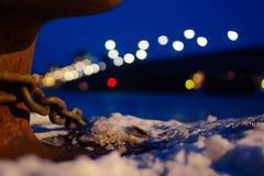 Chain and bridge (Olemik) Tags: desktop bridge winter snow night frozen frost bokeh harbour streetlamp background whitebalance aalborg 2010 circlesofconfusion sigma30mmf14dcex limfjordsbroen aalborgharbour enlightedbridge