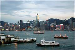 busy harbour - Hong Kong (Maciej Dakowicz) Tags: china city sea urban hk water ferry hongkong evening pier boat twilight asia cityscape view harbour transport tsimshatsui victoriaharbour wanchai