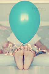 Sad... (Kimberly Chorney) Tags: blue feet 50mm toes balloon naturallight son retro livingroom couch sick hazey sadface