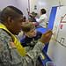 Pvt. Derrick Morris Paints with local Preschool Student