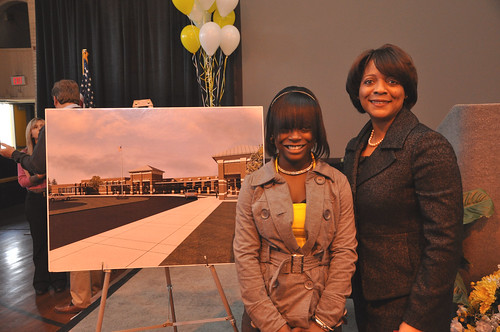 Former Dillon School student Ty'Sheoma Bethea, (L) who wrote a letter about the condition of her school to  President Obama, stands with Rural Development South Carolina State Director Vernita Dore next to a drawing of a new school building funded with Recovery Act loan and grant funds provided through USDA.
